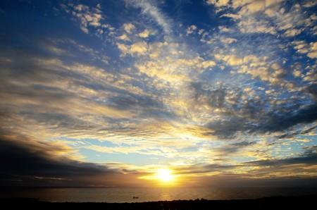 rapanui: Long shot of the sunset at Puna Pau an extinct volcano where the pukaos, or moai headdresses, were built in Easter Island, Rapa Nui, Chile, South America
