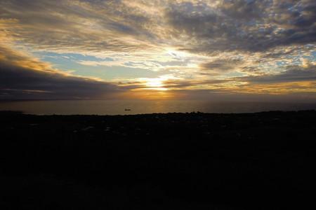 Long shot of the sunset at Puna Pau an extinct volcano where the pukaos, or moai headdresses, were built in Easter Island, Rapa Nui, Chile, South America