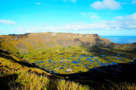 rapanui: Long shot of Rano Kau a large volcanic crater containing a freshwater lake in Easter Island, Rapa Nui, Chile, South America