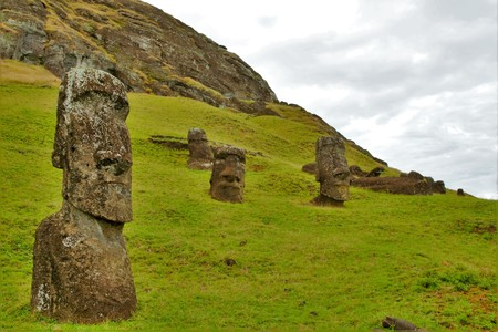 Long shot of Moai statues at the famous Moai statue quarry around the Rano Raraku volcano in Easter Island, Rapa Nui, Chile, South America Stock Photo