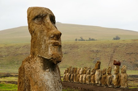Long shot of a row of Moai sculptures at the Tongariki platform in Easter Island, Rapa Nui, Chile, South America Stock Photo