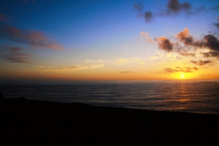 Long shot of a sunset over the ocean in Easter Island, Rapa Nui, Chile, South America Stock Photo