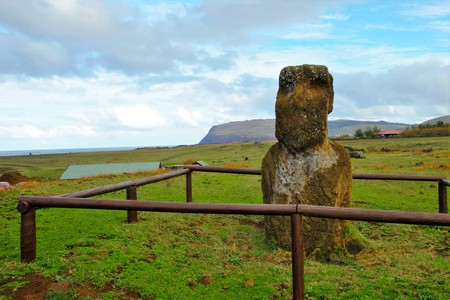 Shot of a Moai statue behind a wooden fence in Easter Island, Rapa Nui, Chile, South America