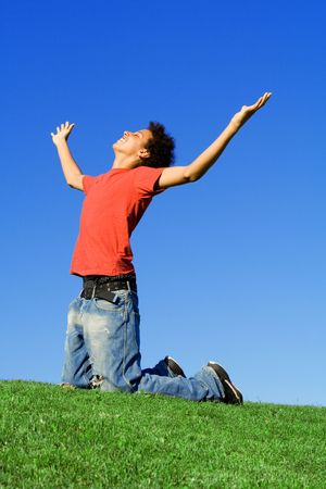 christian faith: christian faith boy arms raised in praise  Stock Photo