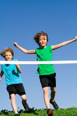 children playing winning running race Stock Photo - 2583965