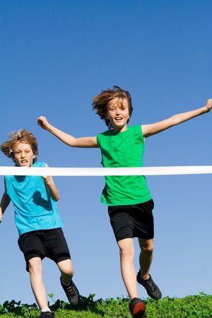 children playing winning running race Stock Photo - 2583965