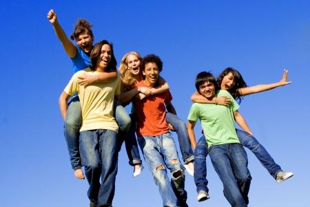 multiracial group playing piggyback race photo
