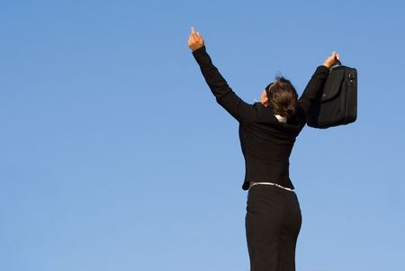 successful business woman arms raised up Stock Photo