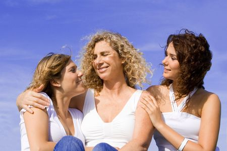 happy mother and daughters