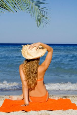 woman relaxing on beach summer vacation photo
