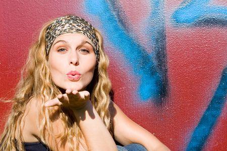 hairband: pretty teen blowing kiss Stock Photo