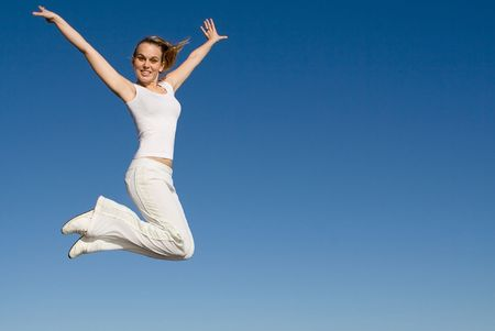 keep: happy young woman jumping for joy