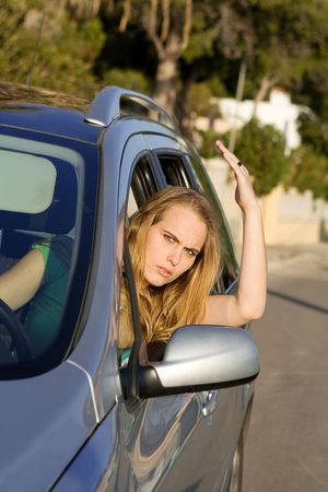 enraged: road rage, angry woman Stock Photo