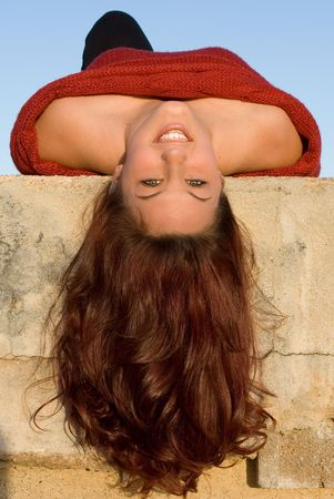 upside: happy smiling woman with beautiful long hair