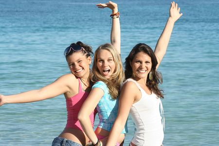 group of friends having fun on summer beach vacation