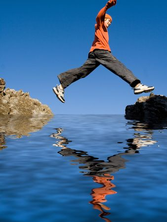 boy jumping rocks,