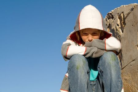grieving: sad child grieving alone