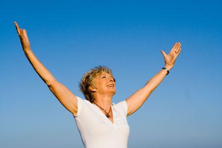 senior woman praising skies Stock Photo - 2650371