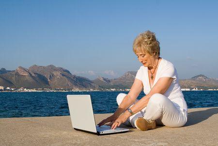 senior woman using laptop Stock Photo - 2650376
