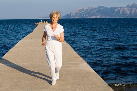 senior woman jogging Stock Photo - 2650370
