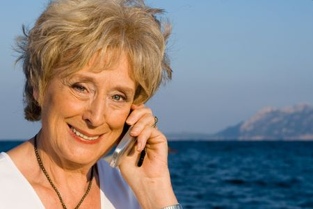 senior woman talking on cell phone Stock Photo - 2650374