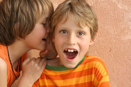 tweens: little children whispering secrets