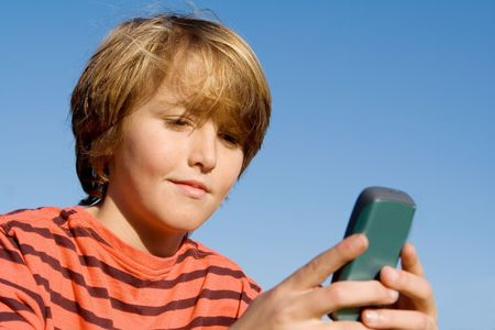 child sending or recieving message on cell phone
