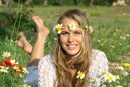 bohemian: pretty girl relaxing in meadow