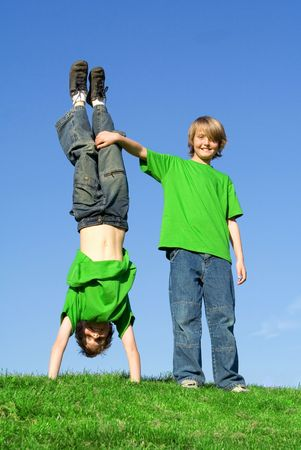 boys playing outdoors Stock Photo