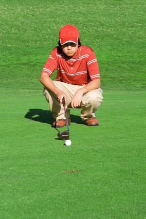 crouching: golfer playing golf