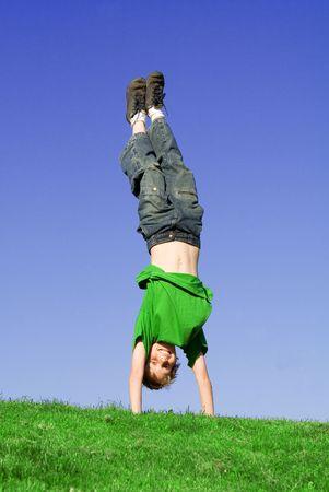 child doing handstand