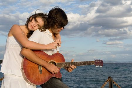 serenading: romantic young couple with guitar