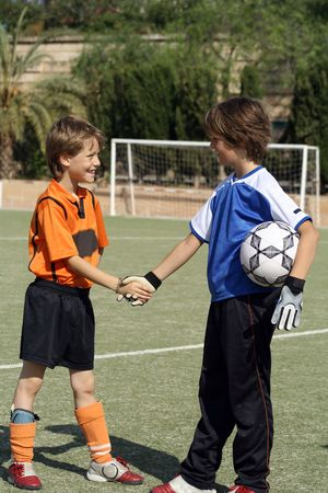 football or soccer players shaking hands