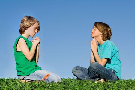 kneeling man: children praying