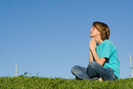 tween boy: child saying prayers Stock Photo