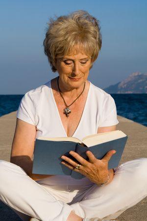 happy senior reading on vacation Stock Photo - 2689354