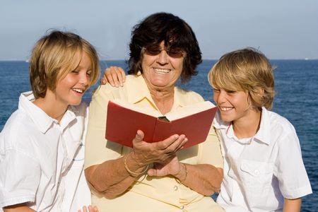 grandmother reading to grandchildren Stock Photo - 2689377