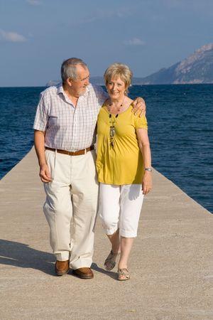 happy senior couple on vacation photo