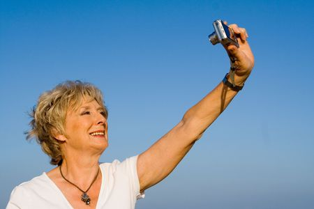 attractive seniors taking photo  Stock Photo - 2689370