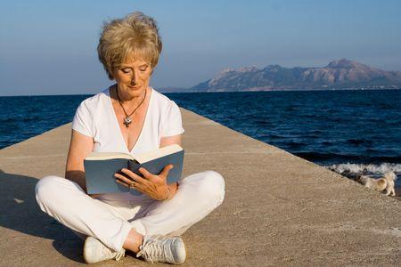 old people reading: senior woman reading Stock Photo