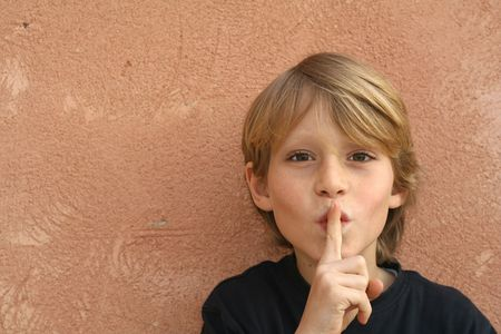 hushing: child with finger on lips