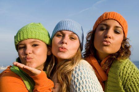 group of teens blowing kisses