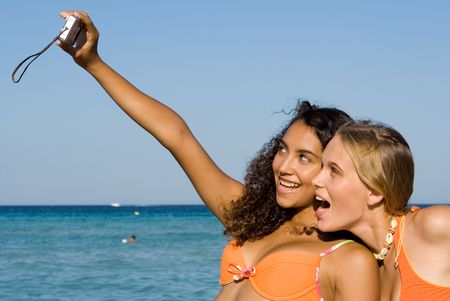 goofing: smiling teenagers taking self portrait on summer vacation