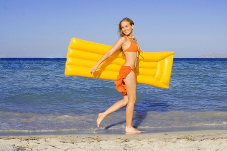 lilo: happy young woman on summer vacation Stock Photo