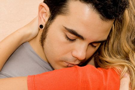 troubled teen: young sad man being comforted by woman Stock Photo
