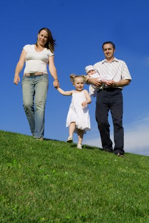 outoors: happy family out for walk Stock Photo