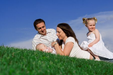 outoors: young family relaxing outside Stock Photo