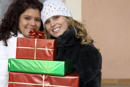 happy young women arriving with gifts Stock Photo - 2722231