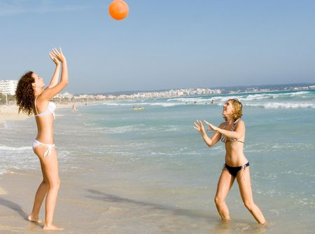 teens playing on beach summer vacation photo