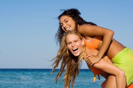 goofing: piggyback fun on beach summer vacation